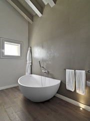 bathtub in a modern bathroom in the attic room