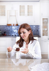 Woman with chocolate cake