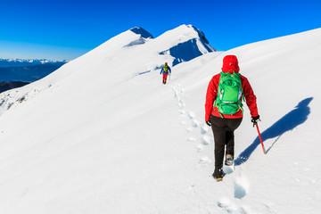 Mountaineers walking on the Kosuta ridge in Karavanke range