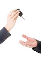Woman giving car keys to the man