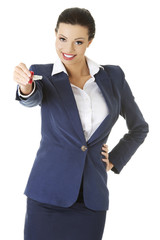 Woman agent holding a key