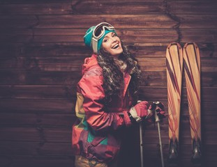Smiling woman with skis and poles