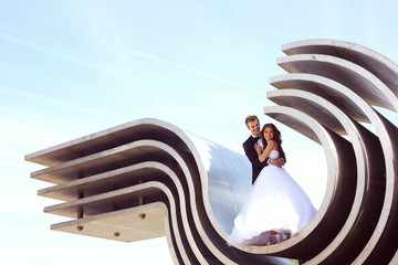 bride and groom under the metal ceiling