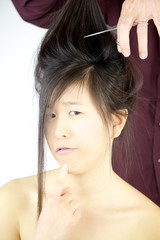 Asian woman not sure to cut long hair
