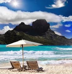 mountain, beach chairs and sea.
