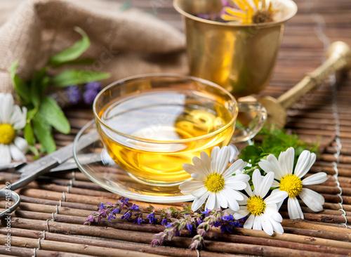 Leinwanddruck Bild Cup of herbal tea