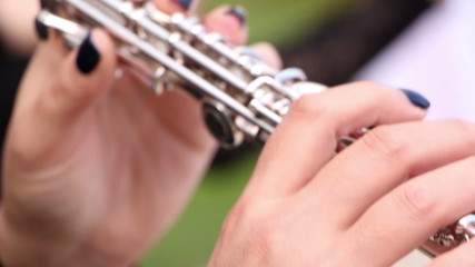 Musician playing on flute