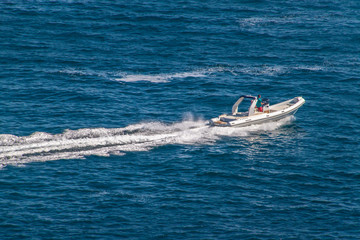 Fast boat on turquoise sea