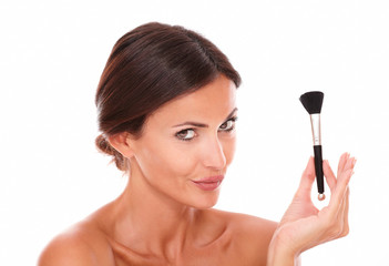 Sensual hispanic female with make up brush