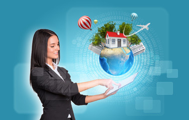 Women using digital tablet. Earth with house and trees