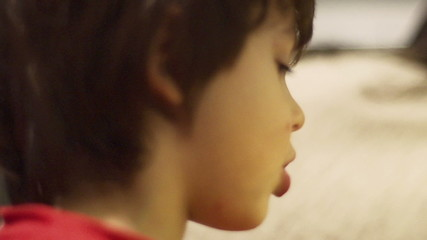 Young boy with mother at home, closeup, steadycam, slow motion