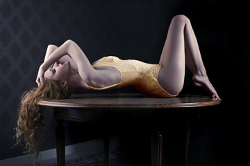 Sensual girl lying in the shadows