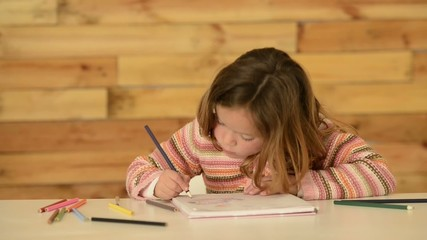 Four years old girl drawing a picture for entretainment