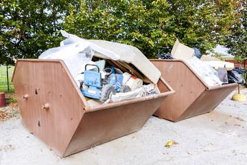 metal bins full of rubbish