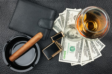 Cigar, ashtray, lighter, money, purse, glass   on genuine leathe