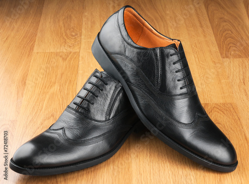 canvas print picture Classic men's shoes stand on the wooden floor