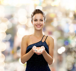 smiling woman in evening dress with diamond