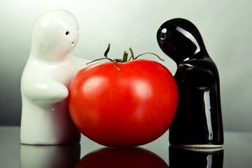 Ceramic figurines holding tomato