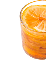 Home remedy of lemon slices and honey in a glass jar over white