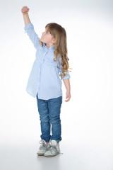 young ambitous kid on white background