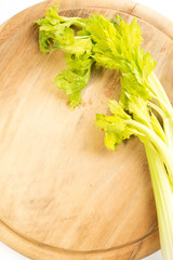 celery on a wooden cutting board
