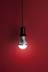 LED bulb on red background