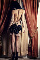 luxury woman in a dress with open back