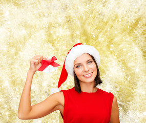 smiling woman in santa hat with jingle bells