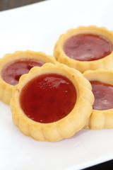Sour and sweet strawberry jam in soft delicious tartlet