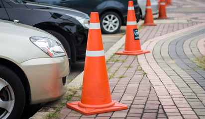Row of traffic cones on footpath