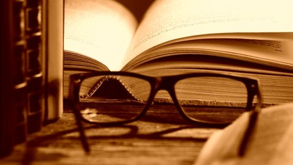 books and reading glasses, zoom in,