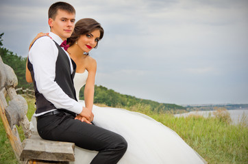 Newlyweds at summer forest