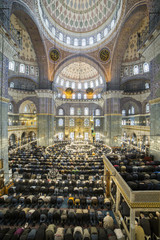 People perform the ritual prayers of islam in New Mosque, Istanb
