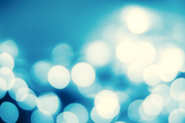 Festive blur background with natural bokeh and bright silver lig