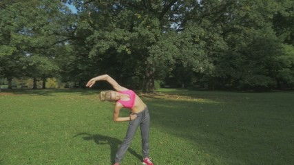 Pretty woman doing the physical exercises