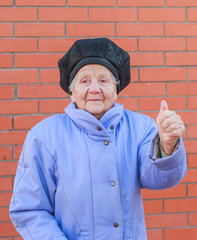senior woman raising thumb up