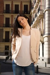 pretty brunette woman standing at street in Madrid city Spain.