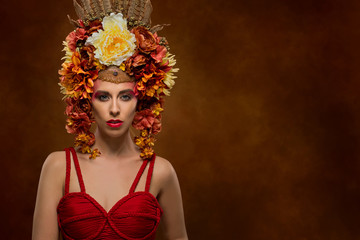 Beautiful woman with flowers in autumnal colours