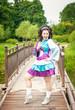 Young beautiful girl in irish dance dress and wig having fun
