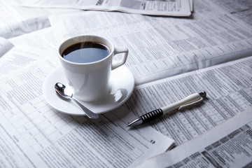 cup of coffee and the newspaper