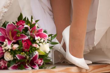 Bride' legs with boquet