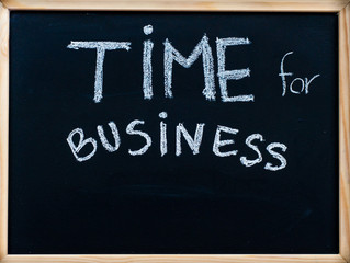 Time for business message handwritten on blackboard