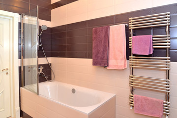 Bathroom interior with the hanging towels