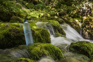 Fresh, drinking water in a glass from a mountains source