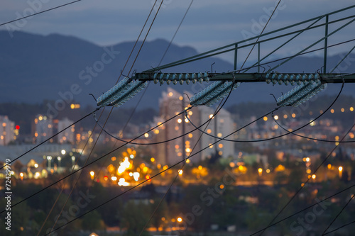 Leinwanddruck Bild High power electricty poles in urban area