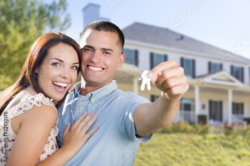 Military Couple with House Keys In Front of New Home - 72430378