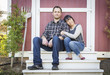 canvas print picture - Mixed Race Couple Relaxing on the Steps