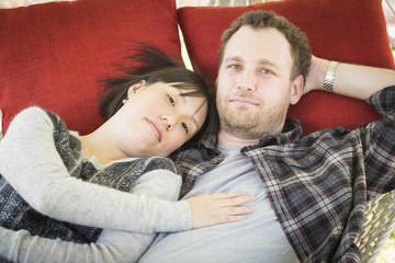 Mixed Race Couple Relaxing in a Hammock
