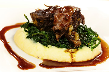 Delicious meal made of beef, spinach and mashed potatoes