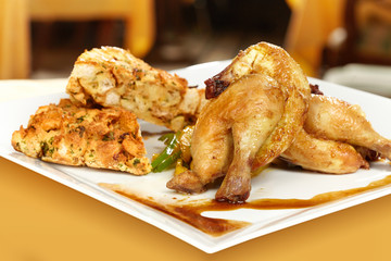 Baked little chicken served on plate with traditional stuffing